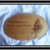 """Welcome to our Home sweet home."" Sign"